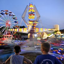 As the sun went down Aug. 5, 2014, the midway came to life with a personality of its own at the Benton County Fair. The fair starts Tuesday.