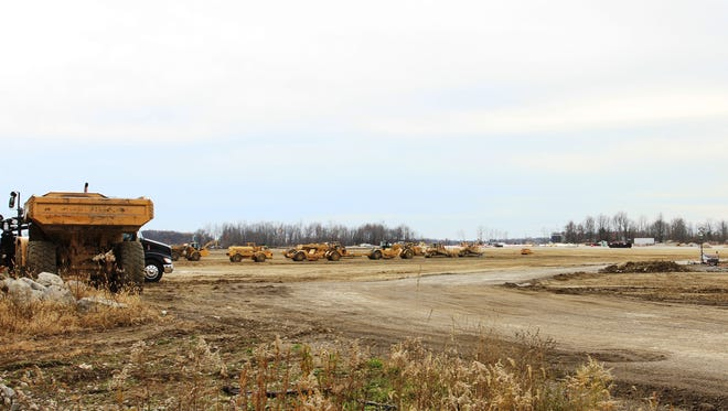 Construction crews are busy preparing this site in Etna Township for a future Amazon fulfillment center. The center could employ up to 1,500 people and be open by next fall, according to local officials.