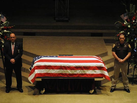 Sheriff Danny Rigel and Major Brad Weathers stood watch over fallen Hattiesburg K9 Officer Benjamin Deen at Temple Baptist Church in May after Deen was killed in the line of duty.