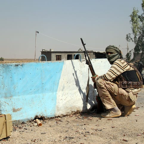 Battling Islamic State militants in Syria and Iraq