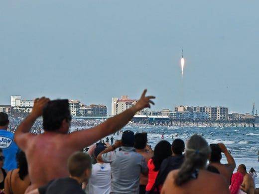 Spectators at Cocoa Beach near Minuteman Causeway watch