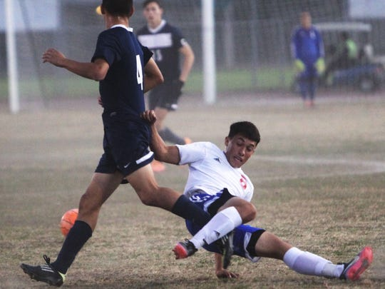 Diego Ceja, of Indio High School, goes down on a hard fought play against La Quinta High School.