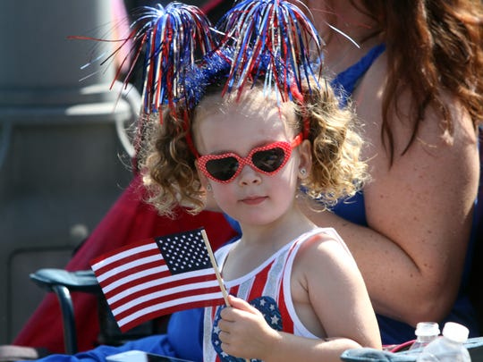 Bella Tambone, age 3, of South Plainfield, watches