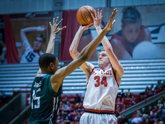 Ball State's Sean Sellers shoots past Eastern Michigan's defense during their game at Worthen Arena Saturday, Feb. 27, 2016.