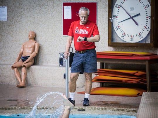 Ball State men's swimming coach Bob Thomas overseas a practice at Lewellen Pool.