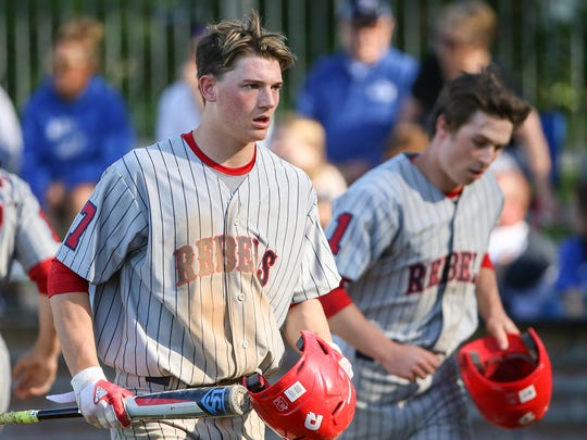 Roncalli Rebel Nick Schnell (7) heads to the dugout