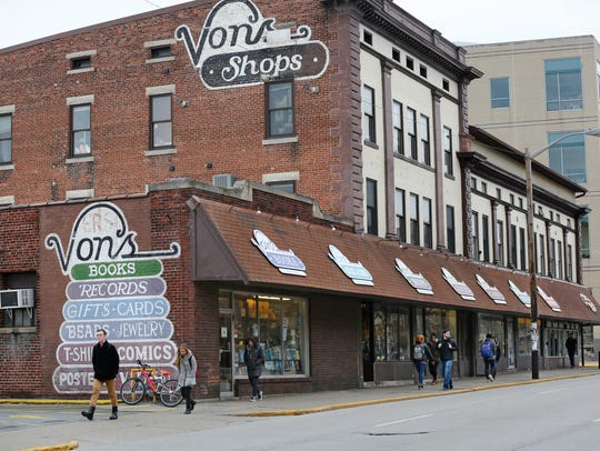 A steady stream of students passes by Von's Shops along