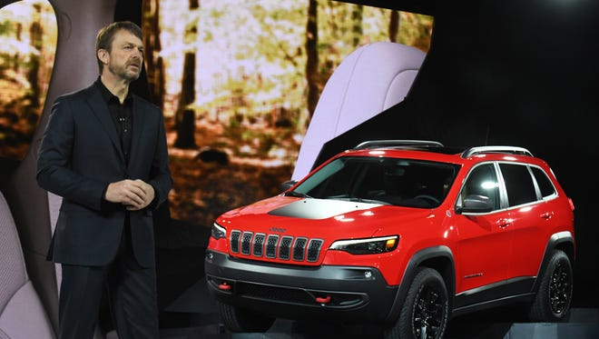Mike Manley shares the stage with a 2019 Jeep Cherokee Trailhawk at the North American International Auto Show in this January 16, 2018 file photo.