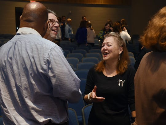 Angie Walls speaks to former colleagues after receiving