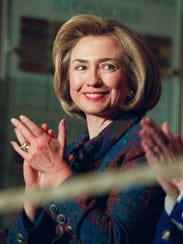 Hillary Clinton claps during a dedication ceremony