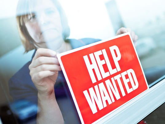 Help Wanted Sign on Retail Display Window for Employment Job Available
