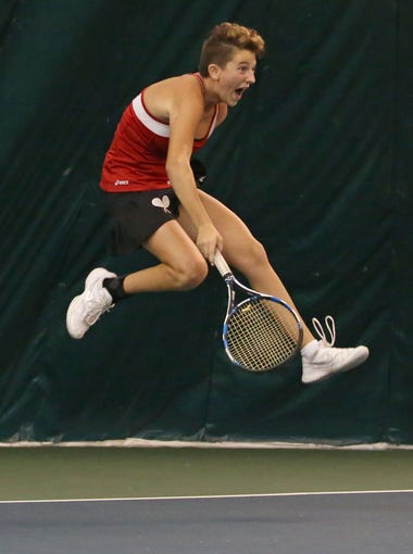 Penfield's Abby Guyon goes airborne as she celebrates a point in the playbacks match.