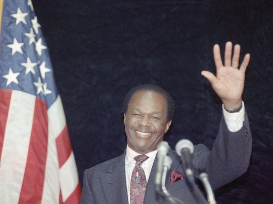 FILE - District of Columbia Mayor Marion Barry waves to supporters after addressing city employees in Washington in this Tuesday, March 14, 1990 file photo. May 21, 1998 file photo. Barry, who staged a comeback after a 1990 crack cocaine arrest, died early Sunday morning Nov. 23, 2014. He was 78. (AP Photo/Bob Daugherty)