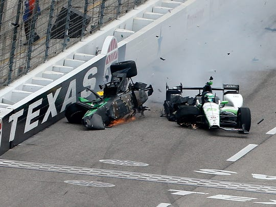 Josef Newgarden (left) crashes into the wall after colliding with Connor Daly (right) in the Verizon IndyCar Series Firestone 600 at Texas Motor Speedway on June 12, 2016.
