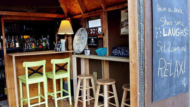 Morgaine Ford-Workman and her husband turned a shed into a bar outside their Morrisville, Penn., house.