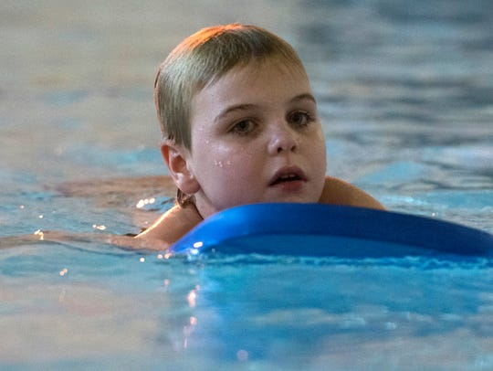Jake Wales, 10, swims laps in the Salvation Army pool