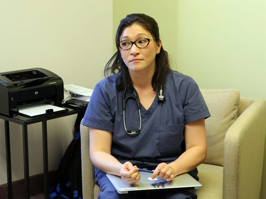 Dr. Junella Chin meets with a patient at Westchester