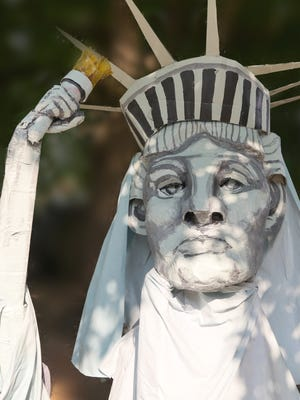 This paper-mache Statue of Liberty was the catalyst for Jessica Ramey's puppet parade.