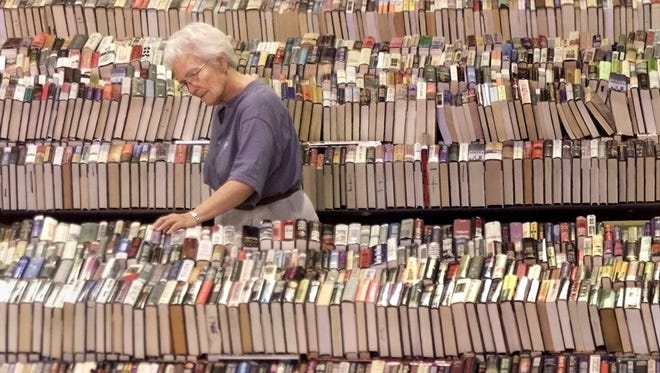Marian Luke checked out the novel section at the annual Planned Parenthood Book Sale at the Iowa State Fairgrounds in 2002.