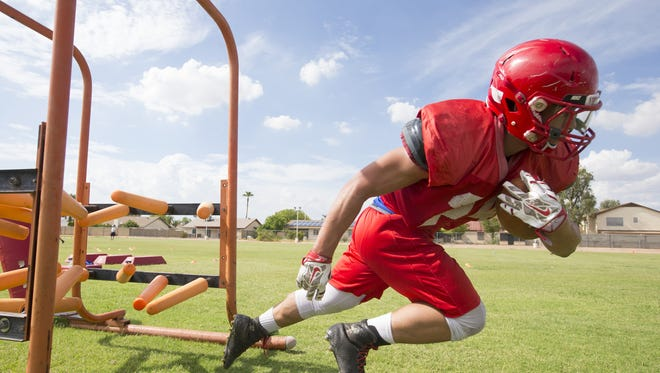 Mountain View High School running back Orion Baker trains during football practice in Mesa on August 4, 2016.