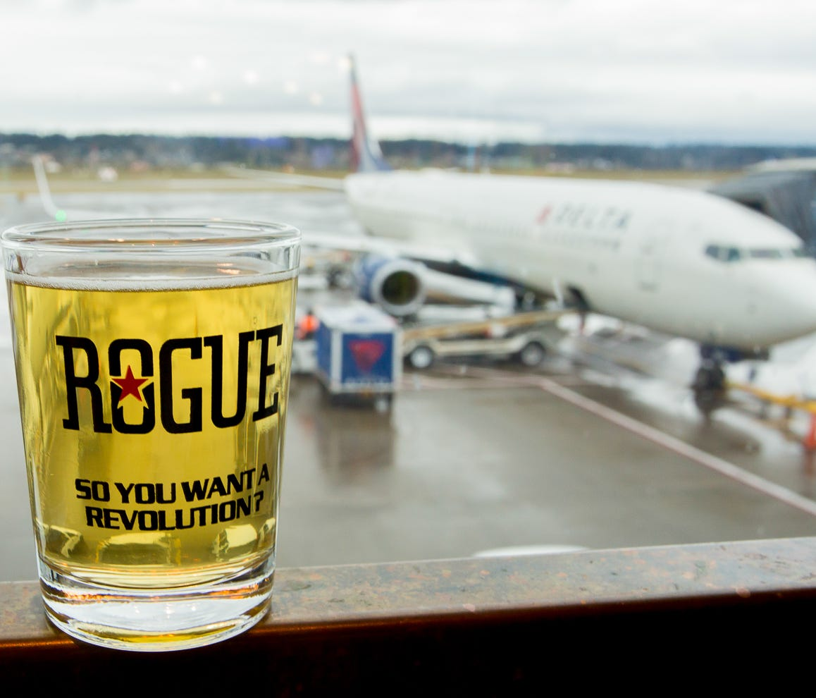 A taster from Rogue Brewery rests on a table at the brewer's Portland (Ore.) International Airport location in February 2017.