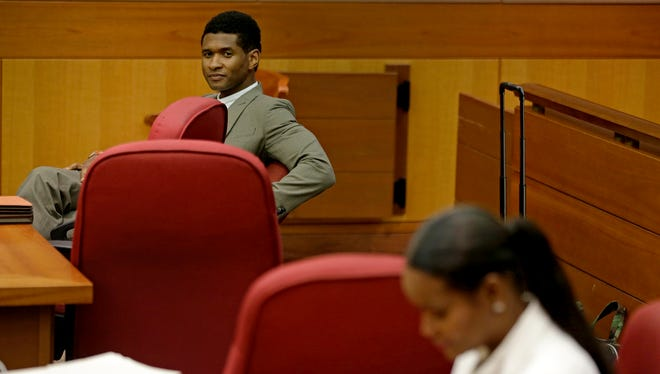 Usher and his ex-wife, Tameka Foster Raymond, wait for a child custody hearing to begin on Friday in Atlanta.