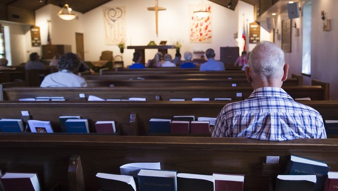 Members of the congregation settle into their seats before a service at St. Paul's Episcopal Church on W. Elizabeth Street earlier this year. St. Paul's will move in with Trinity Episcopal Church later this month.