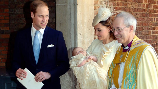 Britain's Prince William and Duchess Catherine of Cambridge leave with their son, Prince George, after his christening Oct. 23 at Chapel Royal in St. James's Palace in London.