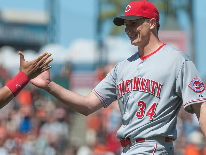 Reds starting pitcher Homer Bailey smiles after pitching a complete game shutout against the Giants at AT&T Park. The Reds won 4-0.