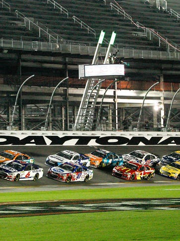 Cars take the green flag amid a slew of empty seats