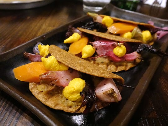Creamy Anasazi bean tacos with roasted summer veggies, pickled carrots, herbs and carrot butter on crispy Pima corn tortillas at Helio Basin Brewing Co. in Phoenix, AZ.