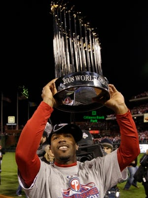 Philadelphia Phillies' Jimmy Rollins holds up the World Series trophy after Game 5 of the baseball World Series.