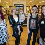 """From left, Toni Maines, Jama Jenkins, Natalie Jenkins, Anna Faulkner and Amber Nussbaumer-Varley pose at Barnes & Noble in Pensacola. These Pensacola-area fangirls are looking forward to the store's """"Fangirl Friday"""" this week."""