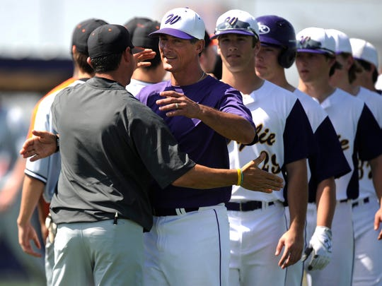Wylie head coach Clay Martin (center) hugs his brother, Burkburnett head coach Grant Martin, after a game in 2017. Grant Martin returned to Wylie in 2018 and will take over the head coaching duties after Clay Martin was named the new head football coach and athletic director on Friday.