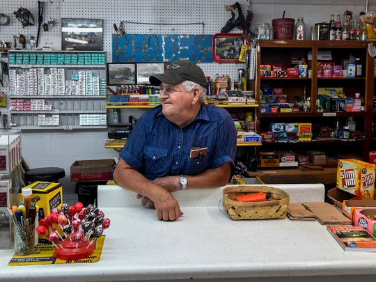 William Rhodes mans the counter at his business, Rhodes Grocery, in Rutledge, Ala., on Thursday August 10, 2017.