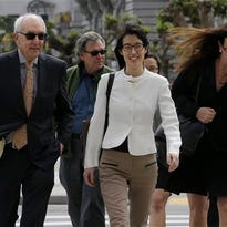 Ellen Pao, center, walks to Civic Center Courthouse in San Francisco, Friday, March 27, 2015. The jury are due back in court on Friday in Pao's lawsuit against Kleiner Perkins Caufield & Byers. Pao says the firm discriminated against her because she was a woman and then retaliated by denying her a promotion and firing her when she complained about gender bias. Kleiner Perkins denies the allegations. (AP Photo/Jeff Chiu)