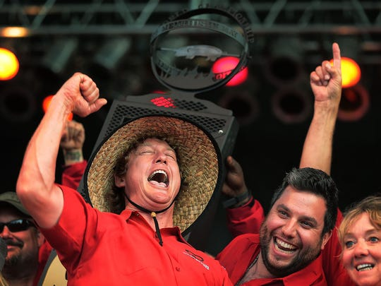 Brad Orrison (left) celebrates with his team after The Shed won the whole hog division at the Memphis in May World Championship Barbecue Cooking Contest at Tom Lee Park.
