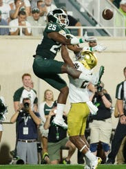 MSU's Darrell Stewart Jr. catches a TD in the first