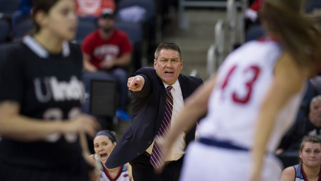Southern Indiana's head coach Rick Stein offers instruction for his defense as they take on Indianapolis during their Great Lakes Valley Conference tournament game at the Ford Center Friday night. Indianapolis beat Southern Indiana 66-48 to advance to the semifinals on Saturday.