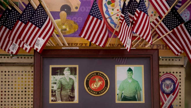 Portraits of U.S. Marines, Jim Miller and J.D. Campbell, grandfather and grandson, are displayed prominently in a section of Miller's 5 & 10 in Boonville, Ind.