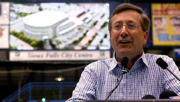 Mayor Mike Huether delivers a speech with an illustration