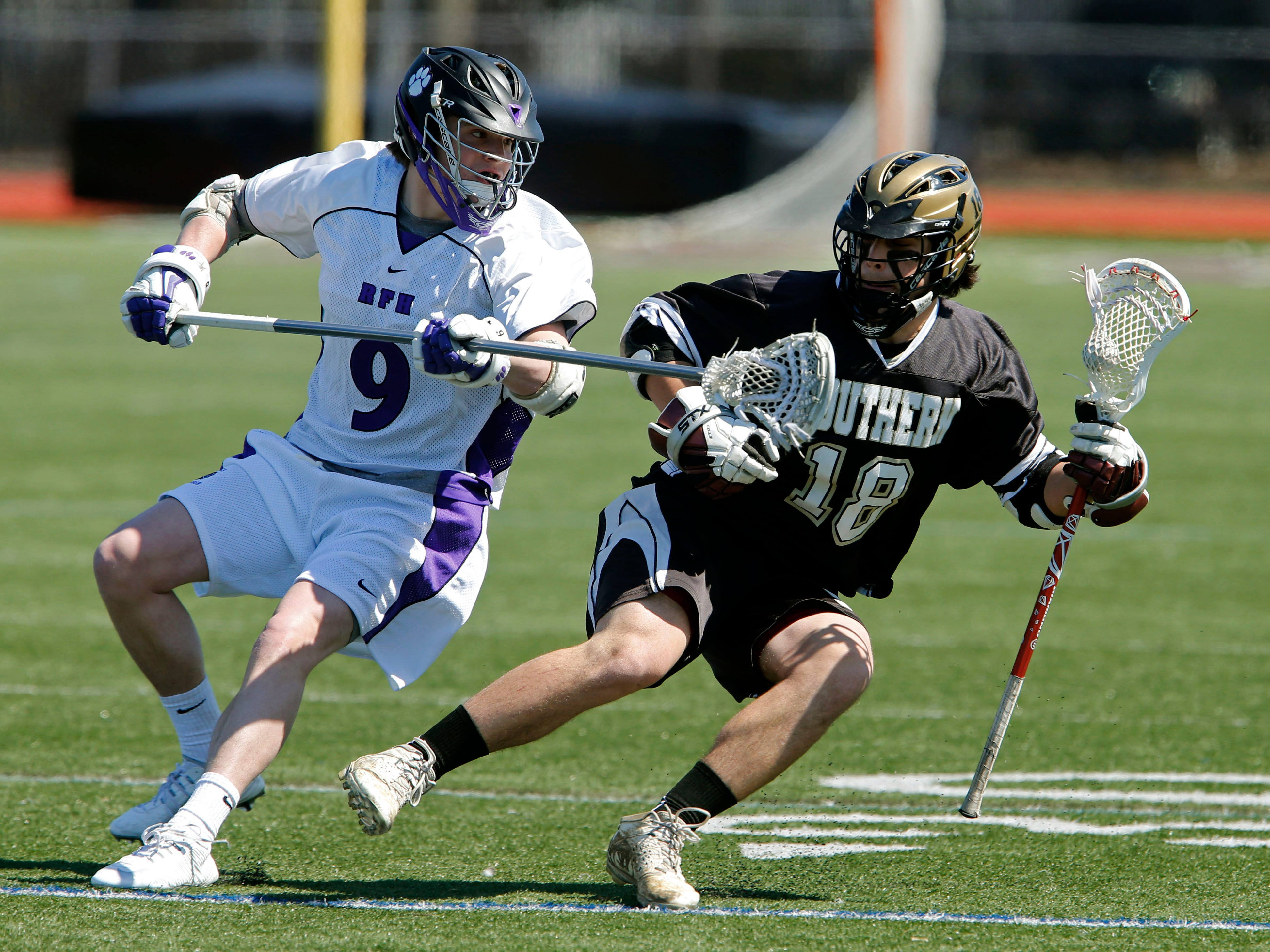 Emmet Jennings (9) of RFH defend against Dylan Jinks (18) of Southern Regional during boys lacrosse game at RumSon-Fair Haven High School. Rumon,NJ. Saturday, April 4, 2015. Noah K. Murray-Special for the Asbury Park Press ASB 0405 Southern at RFH blax gamer