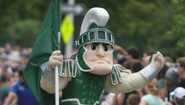 Sparty gets the fans ready for the Michigan State season opener August 29, 2014 at Spartan Stadium in East Lansing.
