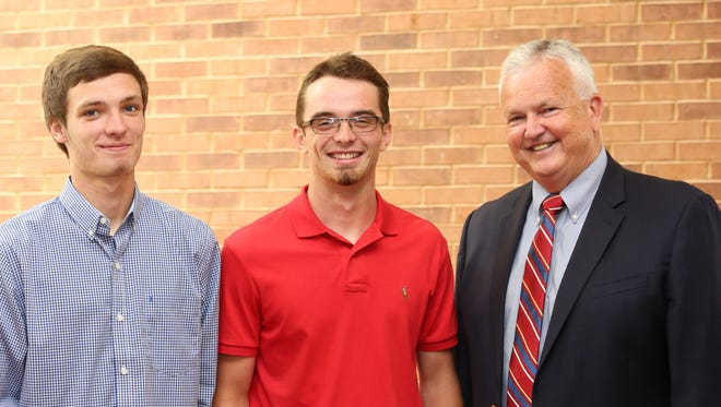 Kyle Shirel and Mason Weldon are greeted by Joe Cain, Commodity Division Director, Kentucky Farm Bureau, during the 2018 Institute for Future Agricultural Leaders (IFAL) at Murray State University.