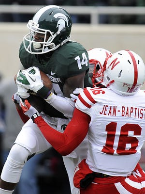 MSU receiver Tony Lippett pulls in a touchdown pass in the endzone                                    against Nebraska's Stanley-Jean Baptiste               two years ago in East Lansing.