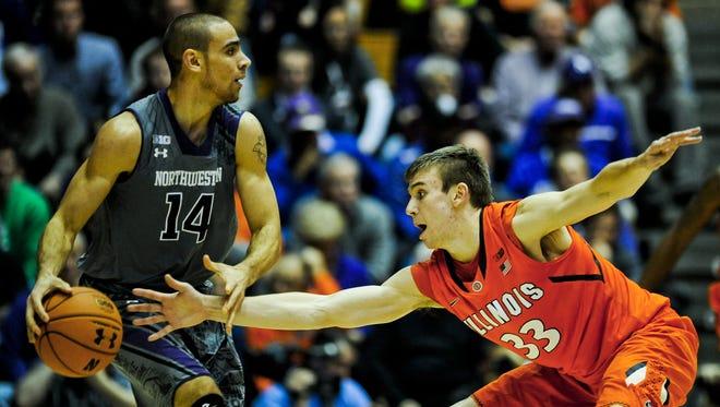 Northwestern guard Tre Demps (14)  dribbles near Illinois forward Jon Ekey (33)during an NCAA college basketball game in Evanston, Ill., on Sunday, Jan. 12, 2014.