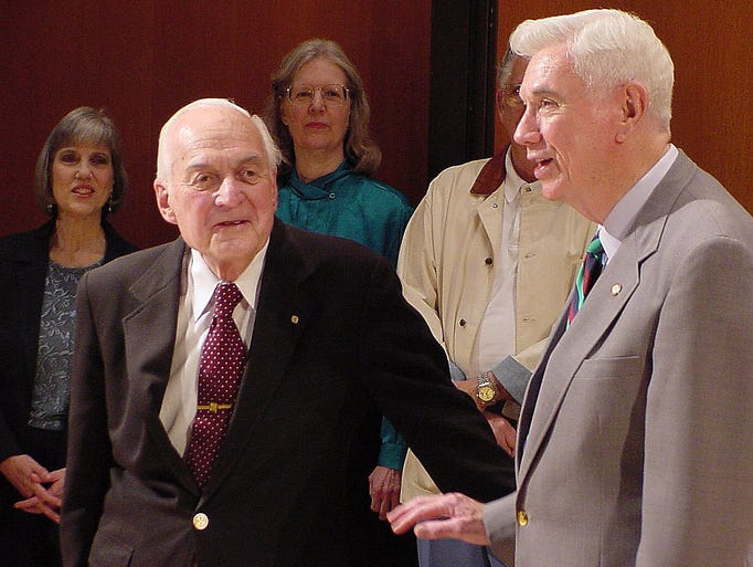 FSU professor Tommie Wright gets honored by former Florida Governor Reubin Askew on Monday.