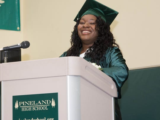 Oluwa Daniels, senior class president at Pineland Learning Center, addresses the audience during the Class of 2018's graduation ceremony.