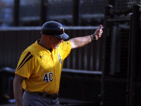 Southern Miss head baseball coach Scott Berry gives