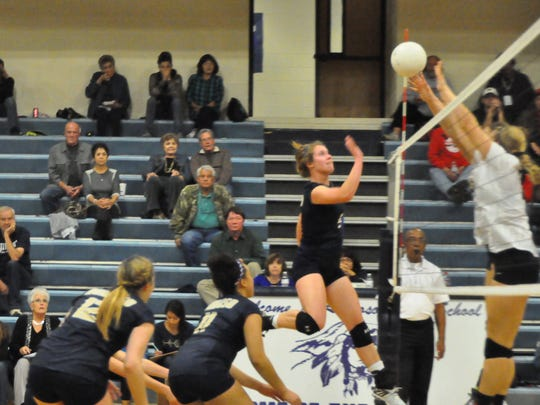 Andi Harrelson taps the ball over the net.